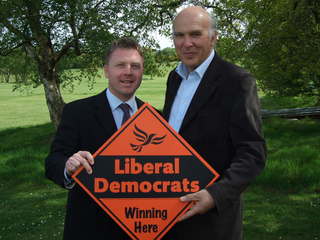 Vince Cable and Nick Perry campaigning